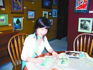 Reiko Hervin demonstrates the watercolor pencil technique she will be teaching at a workshop June 3 in Gardnerville.
